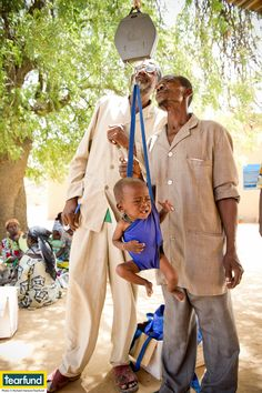 A health worker in Dosso province, #Niger, weighs a severely malnourished 9 month old baby girl as the #food crisis continues to ravage West Africa. Photo Credit: Richard Hanson/Tearfund