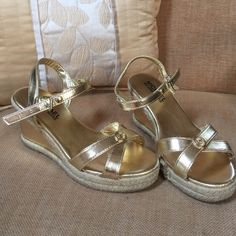 Little girls Michael Kors wedge sandals Metallic gold color wedges with espadrille inspired look. In good condition, but with light scuffs at the back of the heels.  Comes from a smoke free/pet free home Michael Kors Shoes Espadrilles