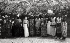 Sierra Leone I 1968 - 1970.In the center is a young Bondo initiate covered in a white clay during one of the stages of her initiation. To her right is the Bondo Masquerade which was known locally as the Bondo Devil  Relates to Bundu mask. Sande Society, Mende peoples (West African forests of Sierra Leone and Liberia). 19th to 20th century C.E. Wood, cloth, and fiber.