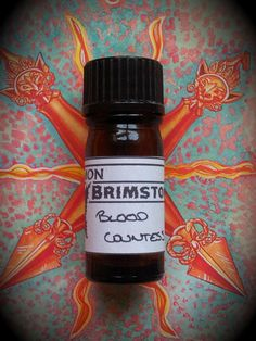 Blood Countess Perfume Oil by CommonBrimstone. Rose, ginger, bitter orange, cedarwood, and red wine. Refined, feminine, and deadly.
