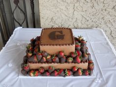 Two Tier Chocolate Grooms Cake With Strawberries. Two tier chocolate grooms cake with chocolate dipped strawberries and monogram. Strawberry Dip, Strawberry Cakes, Groomsman Cake, Groom Cake, Chocolate Grooms Cake, Grooms Table, Chocolate Dipped Strawberries, Covered Strawberries, Occasion Cakes