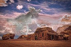 Southwest desert landscape, Navajo Indian Rock house with lightning striking behind. This image is a composite fine art color print. HDR Version. Fine art photography prints, decorative canvas prints, acrylic prints, metal Prints wall art  for sale on FineArtAmerica.com. Prints starting at $25. Copyright: James Bo Insogna