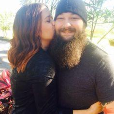 WWE Superstar Bray Wyatt (Windham Rotunda) gets a sweet kiss from his wife Samantha
