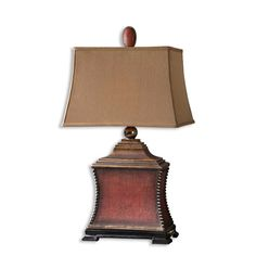 Aged red finish over a woven textured base with antiqued silver beaded accents, matte black foot and heavily antiqued gold details. The rectangle, semi bell shade is a silkened, rust taupe textile.