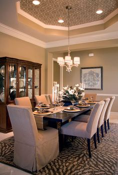 A example of a Coffered Ceiling in a Dining Room.  A Coffered Ceiling is an inset panel in the shape of a square, rectangle, or octagon in a ceiling. It adds visual interest to what would normally be a flat surface.