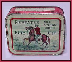 REPEATER TIN with a Mountie on the lid. Fine Cut smoking tobacco.