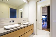 Warralily Coast Display Home - Caroma tapware and basins. Cabinets in Laminex Sublime Teak - use timbergrains horizonal for a sense of space.