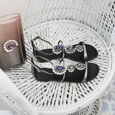 Large coloured crystals are set within an array of clear stones, bringing a sense of playful movement with every step. The smart strapped leather design fastens with a buckled ankle strap.