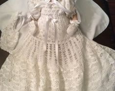 PDF crochet pattern for poinsettia filet christening gown, cap and headband. The gown is perfect for those christenings held around the holidays. The gown will fit a baby up to 6 months. The pattern is set up to use no. 10 crochet thread. It is 28 inches long and the waist is 19 inches.