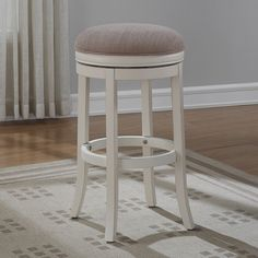 American Woodcrafters Aversa Backless Swivel Bar Stool - Turning bars into bistros, the American Woodcrafters Aversa Backless Swivel Bar Stool is designed to take your classic or transitional style to th...