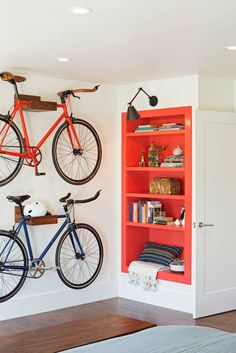 How to hang a bike from the ceiling pinterest organizations hgtv regan baker designed a multifunctional bedroom with a bright white palette wood plank walls and bike storage the bedroom is separated from the solutioingenieria Gallery