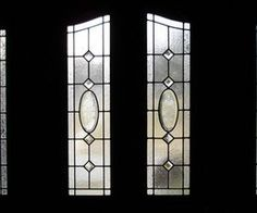 Double door with frosted leaded glass sidelights.