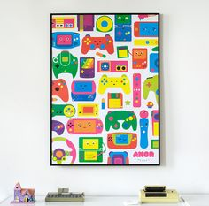 """Really, what office or home wouldn't look more cheerful decorated with these cute handhelds rubbing elbows with game controllers and media?"""