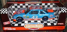 """American Muscle Richard Petty #43 STP Grand Prix 1/18"""" Scale Die Cast Car Collector's Edition by ERTL. $43.99. Steerable Front Wheels and Opening Hood. Detailed 600+ HP 358 Cu. In. V-8 Engine, Fully Detailed Racing Chassis and Suspension. Complete Interior with Roll Cage.  Fire Extinguisher and Instruments. Fully Assembled. Painted In Authentic Colors with Full Color Graphics. Richard Petty #43 STP Grand Prix 1/18 Scale Diecast Car.Made by Ertl American Muscle . Marked # 7461..."""