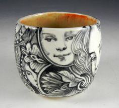 Black and white porcelain tea bowl/ cup with eye, rabbit ,faces and imagine on Etsy, $38.00