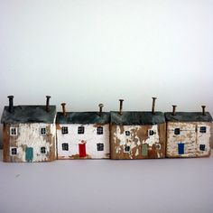 Driftwood Cottages with nail smokestacks