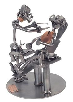 "- Created by Artist Guenter Scholz - 7 "" Tall - Hand crafted from recycled steel - H & K Steel Sculptures"