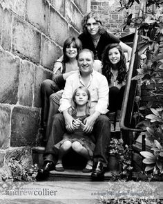 Love, love, love black & white. I like the use of the stairs as well. Maybe wife in front of husband and kids all around the back of the husband? Family Portrait Poses, Family Picture Poses, Family Photo Sessions, Family Posing, Picture Ideas, Photo Ideas, Pictures On Stairs, Fall Family, Family Of 5