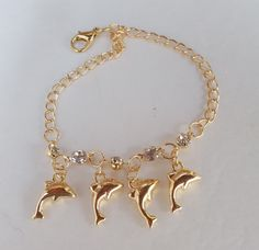 """14K Yellow Gold Filled Dangle Charm 4 Dolphins Gold Filled 5 Austrian Crystals Unique Design Delicate Ladies 6 1/2"""" Bracelet by DiamondLylly on Etsy"""