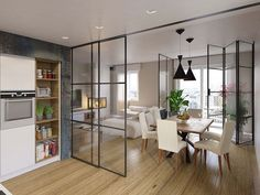 Cocina y comedor independientes con puerta corrediza de vidrio en metal. #cocina #cocinas #comedor
