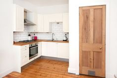 Edinburgh Victorian tenement flat refurbishment - original wooden flooring + stripped wooden doors - cream IKEA shaker kitchen + wooden worktops Cream Kitchen Cabinets, Ikea Kitchen, Living Room Kitchen, Flat Interior, Kitchen Interior, Interior Design, Kitchen Designs, Kitchen Ideas, Olive Bedroom