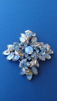 Delizza and Elster Juliana Brooch with Blue Girve Rhinestones .