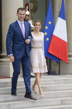 King Felipe and Queen Letizia took an official royal jaunt over to Paris. Her majesty opted for a figure-flattering lace-embroidered Felipe Varela dress with a matching clutch and strappy platforms by Magrit.   Queen Letizia's Style Rocks Our Royal World. Her Chicest Looks Ever