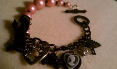 Vintage style pink and black charm bracelet by Victorian Edge Jewelry