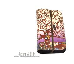 Hey, I found this really awesome Etsy listing at https://www.etsy.com/listing/198878468/leather-phone-wallet-tree-of-life-custom