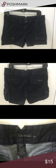 Calvin Klein black denim shorts Cute shorts, like new.  The denim has a little stretch so they will be extra comfortable.  Cute side cargo pockets with two snaps and front pockets.  Back pockets are faux. 3 1/2 inch inseam. Calvin Klein Shorts Jean Shorts
