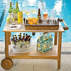 Roll It Out    A space- and wallet-friendly alternative to building a full outdoor bar, this portable serving cart can double as a stationary drink station for parties. The retractable leaf extends to create more space for holding bottles, mixers, glasses, and garnishes, so guests can stay well-stocked. Avoid broken-glass disasters with durable acrylic drinkware. Choose a set with a hammered texture like this one for a look that most closely resembles high-end glassware.