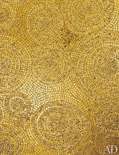 The Fancy Gold collection of 24K-gold-and-glass mosaic tiles by Sicis shimmers and shines. Other colors and custom sizes available; price upon request. sicis.com, 877-839-8900