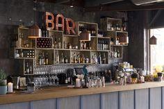 Bar interior idea - fantastic use of box's and crates! Bar is SoCal in neutral bay. Rustic Restaurant, Restaurant Design, Restaurant Bar, Back Bar Design, Pallet Bar Plans, Interior Designers Sydney, Porch Bar, Bar Shed, Bar A Vin