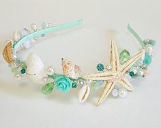 All my accessories is brand new as it has been handmade by CyShell.   This elegant piece made with seashell,starfish,white and ivory pearls,flowers,biwa pearls, crystals This headband is perfect for bride, bridesmaid, and flower girl.  Shipping: Your item will be carefully packaged and shipped usually the next day after payment is received. Thanks for looking!  https://www.etsy.com/shop/ZhannaDesign?ref=si_shop
