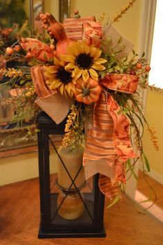 My Mother gave me this beautiful lantern. I think I will try this arrangement for fall.