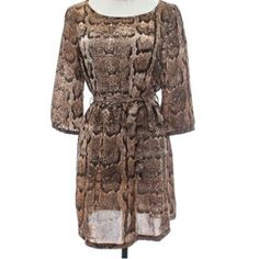 "H&M Animal Snakeskin Print Dress SZ.10 H&M Animal Snakeskin Print Dress, 3/4 Sleeves, w/ Belt Self Ties at Waist. Waist is elastic, so it is stretchy.               Flat Lay Measurements: Bust 19"" Waist 13.5 Length 32.5""  100% Polyester H&M Dresses"