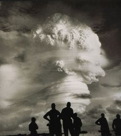 Men watch a mushroom cloud from one of 216 above-ground or underwater nuclear test explosions in the U. between 1945 and when they were driven underground by the Limited Test Ban Treaty. Bomba Nuclear, Nuclear Bomb Test, Nuclear War, Nuclear Energy, Hiroshima Et Nagasaki, Enewetak Atoll, Mushroom Cloud, Historia Universal, Arms Race