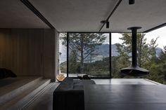 Mountain House Architecture - cozy mountain retreat integrates into surroundings in New Zealand I just love the fireplace New Zealand Architecture, Architecture Design, New Zealand Mountains, Villas, Bedroom With Bath, Mountain Homes, Mountain Modern, Fireplace Design, Detached House