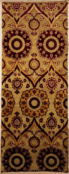 """Turkey, ca. 1550-1599  """"Ottoman silk velvets made in the 16th century often have patterns based on Italian models. Here, an arched lattice links alternate rows of roundels with crimson grounds and yellow grounds. Only the presence of tiny tulip heads in the crimson-ground roundels suggests that this is an Ottoman textile. These tulip heads also help to date it. They were introduced in the 1550s, so this velvet must have been made after that time."""""""