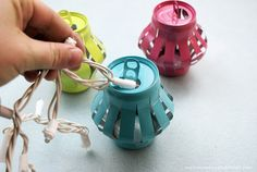 How to Make Chinese Lanterns For Ambient Light Day or Night Learn how to make Chinese lanterns that you can string inside or outside your home for parties or events. They are wonderful upcycles made from soda cans! String Lanterns, Can Lanterns, How To Make Lanterns, Paper Lanterns, Diy Chinese Lanterns, Tin Can Art, Soda Can Art, Tin Art, Aluminum Can Crafts