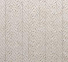 Chevron is a popular pattern in modern tiles. Tangent's Chevron in Crema is a beige stone mosaic tile based on the geometry of triangles.