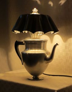 This curvaceous lamp is made of from a vintage aluminum percolator and a couple of fluted  dessert molds. Original glass percolator bubbler is set into the shade.