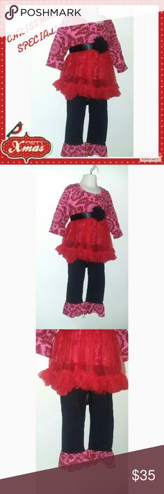 *Girls Sassy Is Best Boutique Outfit Beautiful Sassy Boutique Outfit. Sure to please with this beautiful outfit. Long sleeve red design top with beautiful shear tutu like outside. Cotton black pants with ruffle bell bottoms. Unique and very rare boutique quality and design. Comes with detached black flower belt. Matching Sets