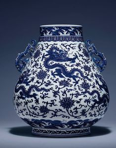A magnicient and fine blue and white 'Dragon' hu-shaped vase, Qianlong six-character archaistic seal mark and of the period (1736-1795)