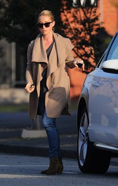 Cool and casual: Asher wore dark T-shirt and brown jacket teamed with a pair of blue jeans. Brown Jacket, Wet Hair, Free Makeup, Style Ideas, Blue Jeans, Winter Outfits, Style Me, Weather, Fashion Outfits
