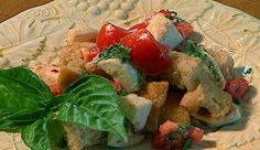 Summer tomatoes, fresh basil, mozz and rustic bread...with a wonderful dressing. I could eat it every day!