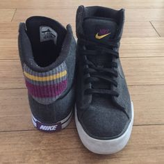 MAKE AN OFFERGrey high top nikes Grey high top nikes. Purple, light gray and yellow on back of shoes. Leather Nike sign.  Bundles save Make an offer  No trades  My price allows for negotiation so feel free to make a reasonable offer!  Nike Shoes Sneakers