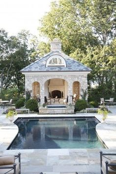 Traditional East Coast-style stone pool house and patio.
