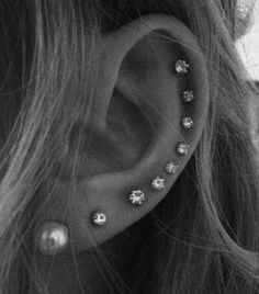 For major impact, consider studding your ear all the way up with pearls and diamonds.