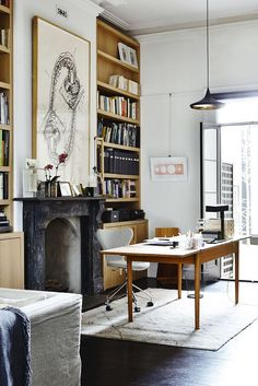 Modern office in victorian home with black marble fireplace